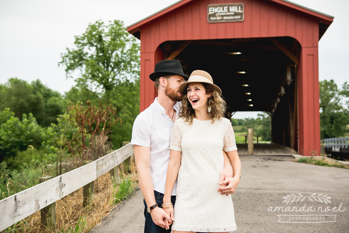 Springfield OH Engagement Photographer | Amanda Noel Photography | stylish lifestyle engagement session covered bridge and field at sunset