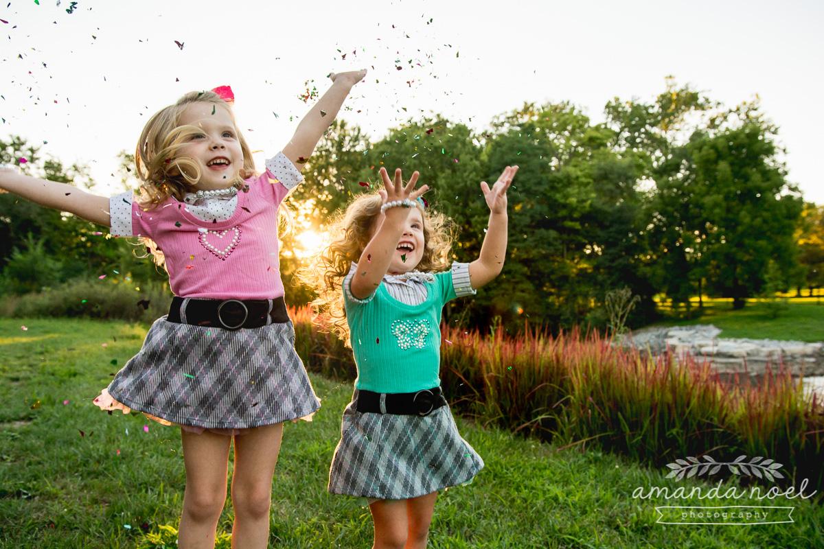springfield ohio lifestyle family photographer | Amanda Noel Photography | twin girls 4th birthday | girls throwing confetti in pretty light