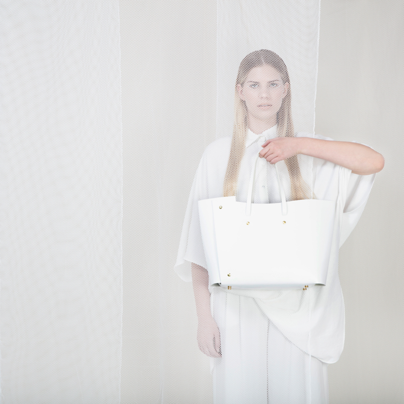 sq-tote-white-model.jpg