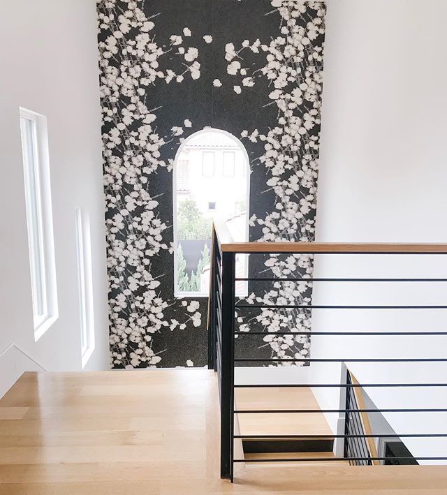 One of my favorite places to install wallpaper is where you least expect it but has the greatest impact... the stairwell.  @elitisfrance #tammytrylkointeriors