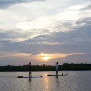 Stand up paddle boarding has existed in some form or another for thousands of years. South American and African cultures used boards, canoes, and other handmade watercraft along with a long stick to propel themselves to travel, fish or ride waves for recreation.