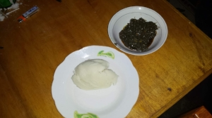 Eru is a traditional meal of Cameroon. It is a green leave that is picked, washed, chopped and boiled down with red oil. You use your hands to take some fou fou and grab the Eru. Normally there is dried fish and cow skin mixed in. A favorite of every Cameroon and brave foreigners!