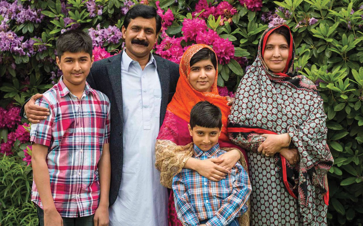 Malala with her family in Birmingham, England after recovery.