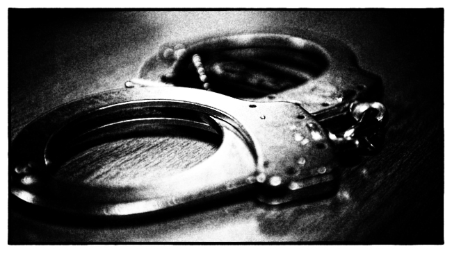 1024px-Handcuffs_on_table.jpg
