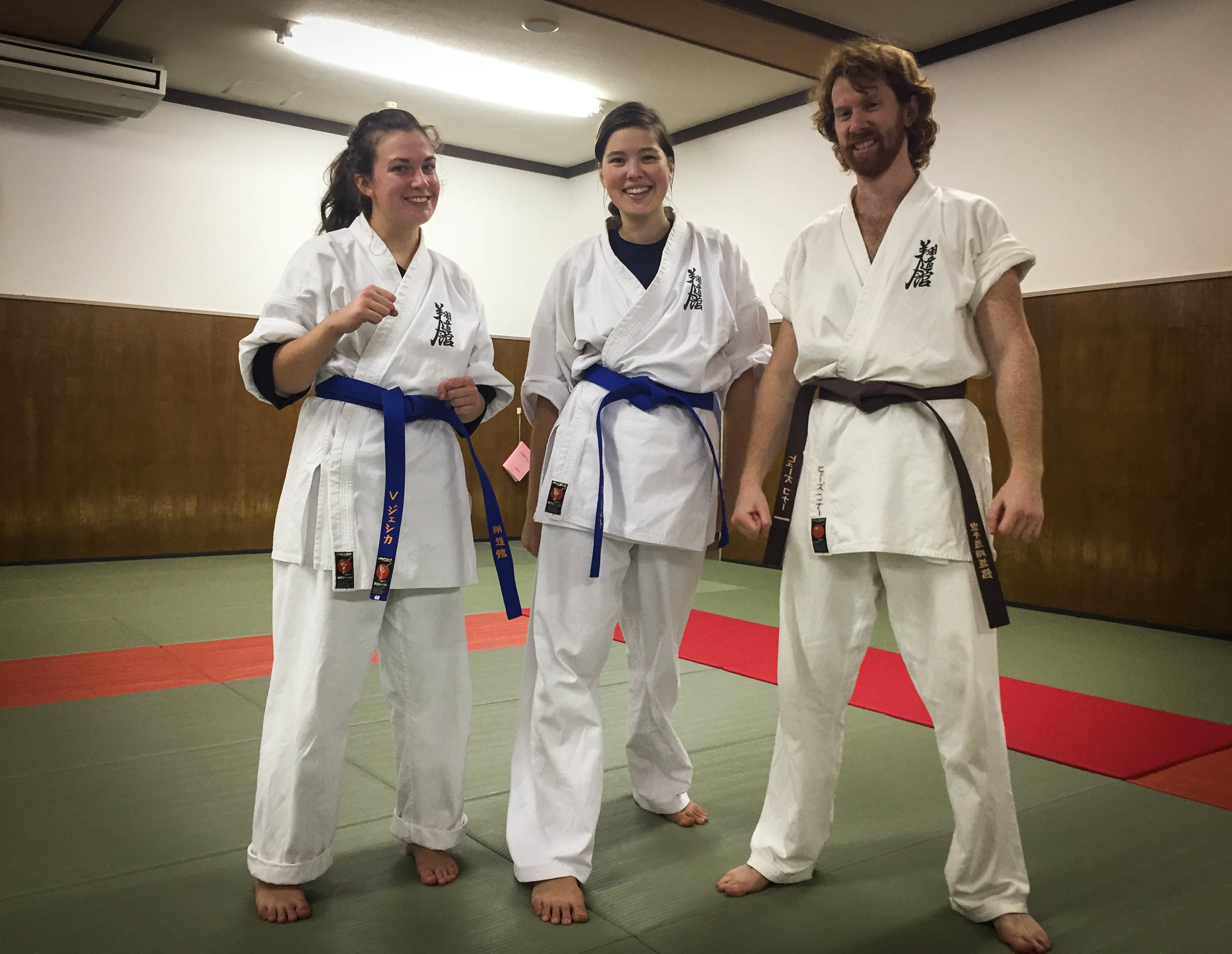 Our first coloured belt-- blue! But more importantly, where did my left arm go??