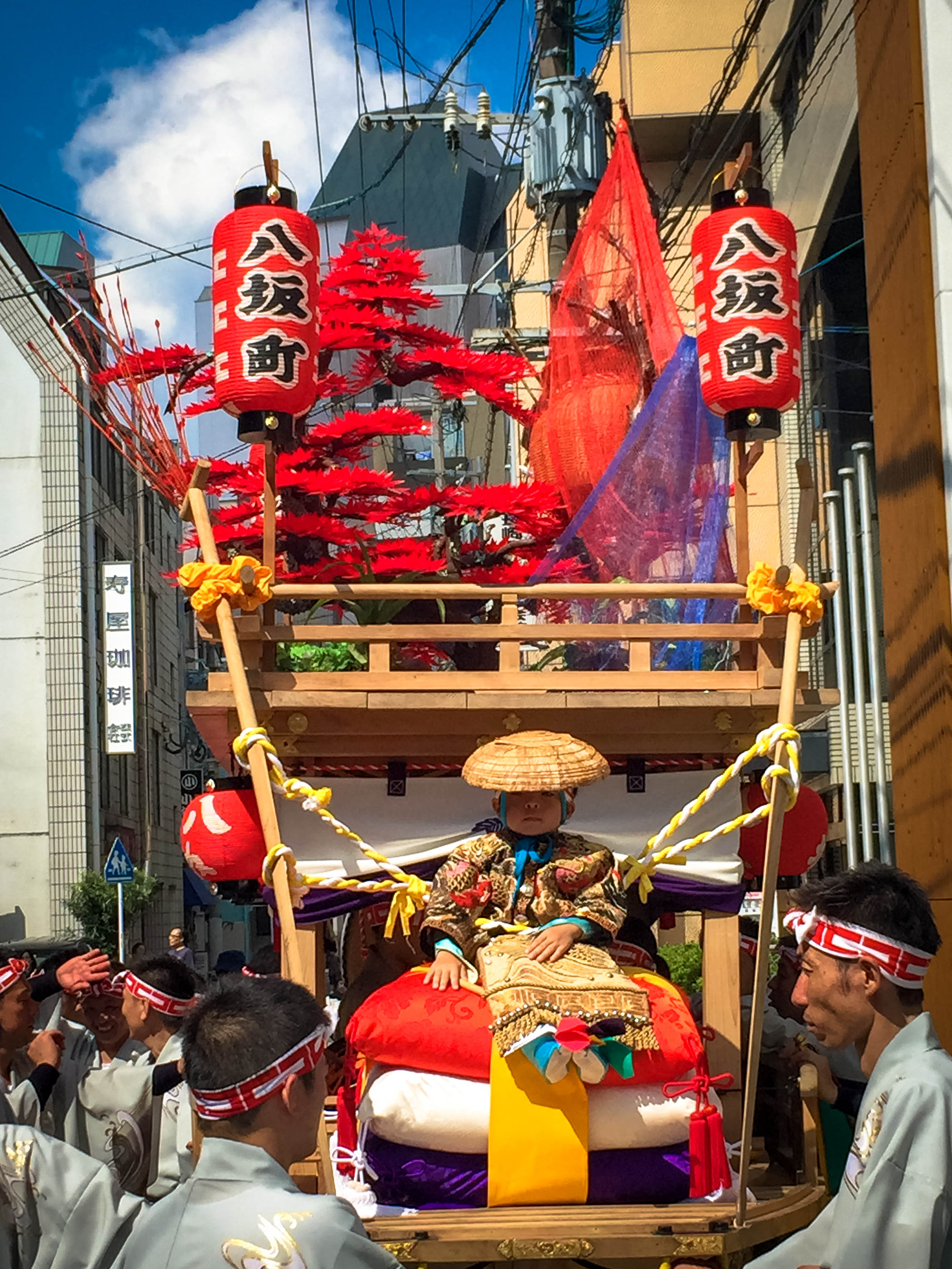 The best part was this one child being carried aloft a float sitting on no less than three massive pillows like the true supreme ruler he is on the inside.