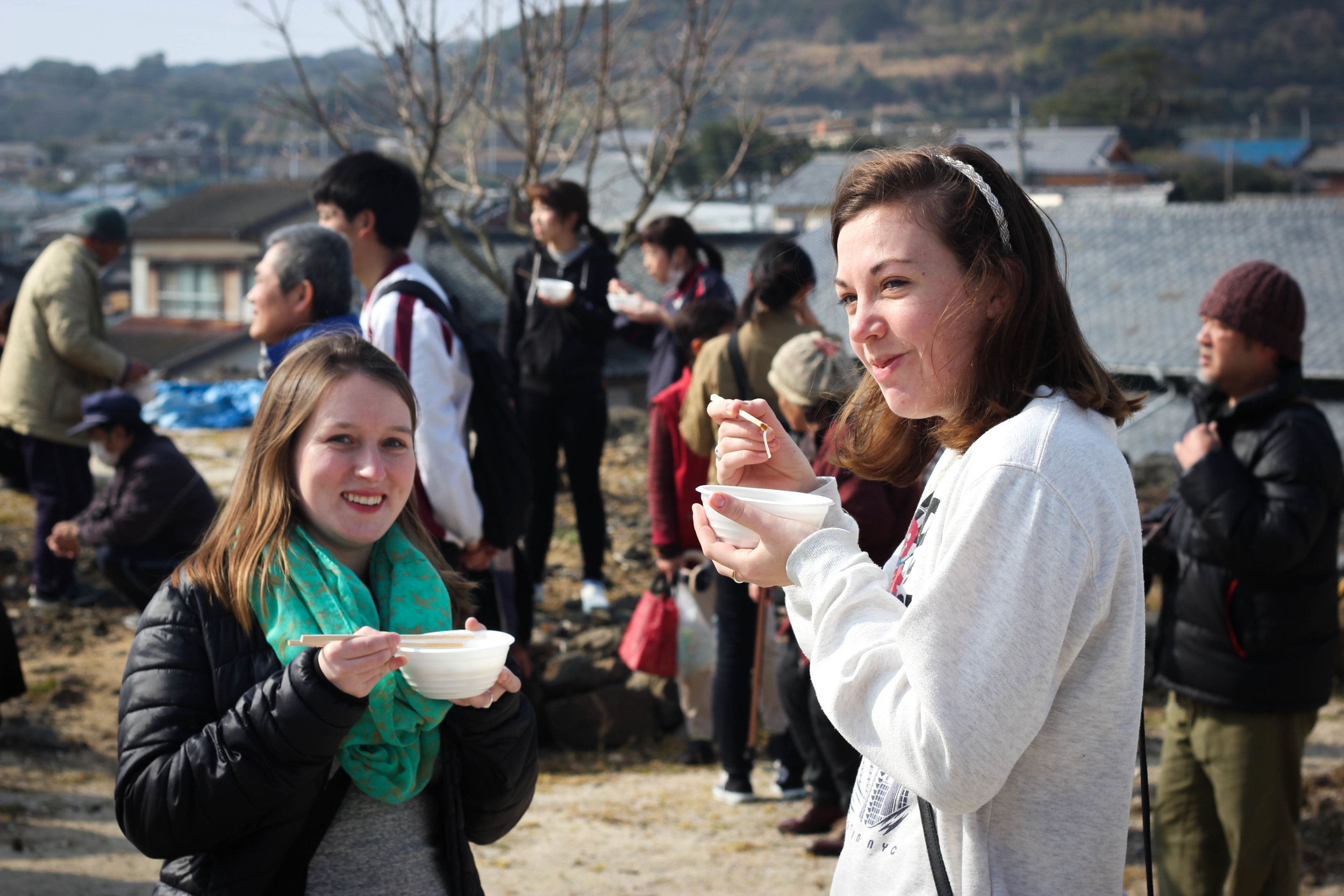 Erica and Jess enjoying some hot soup prepared by the people of Sakiyama.