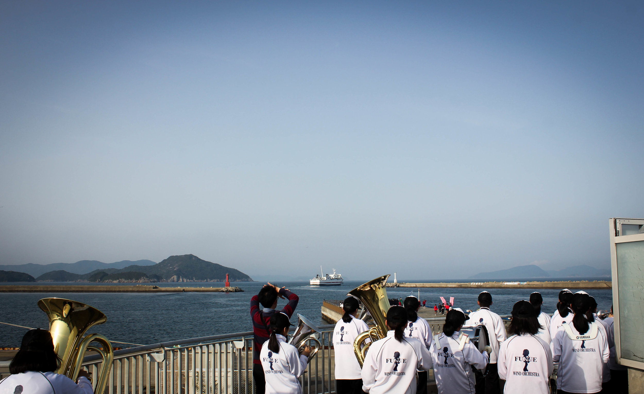 The Fukue Junior High School band set up on top of a lookout point and playing the ferry out until it is out of sight. I stood behind, silently weeping lol.