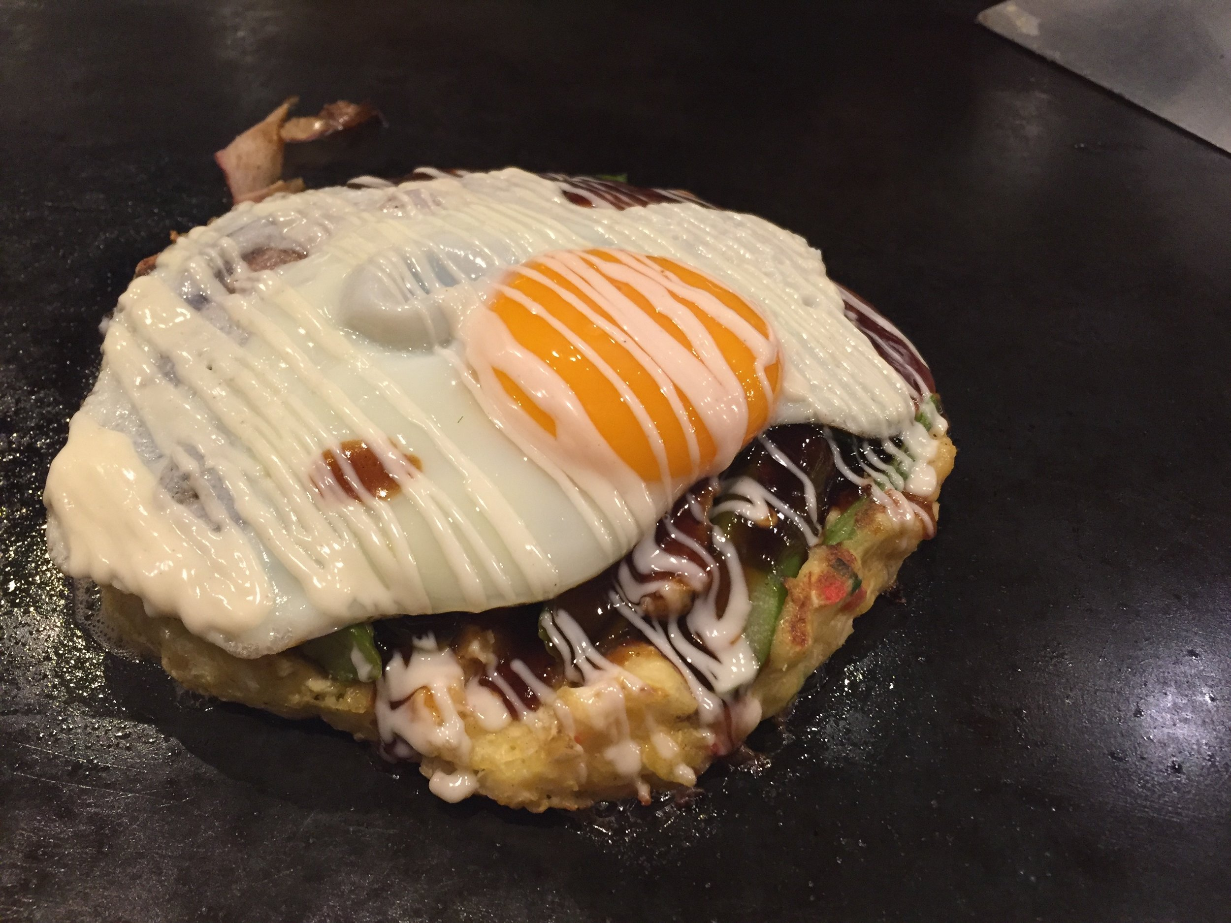 Different variations of okonomiyaki. Both 'Osaka' style as they don't contain noodles.