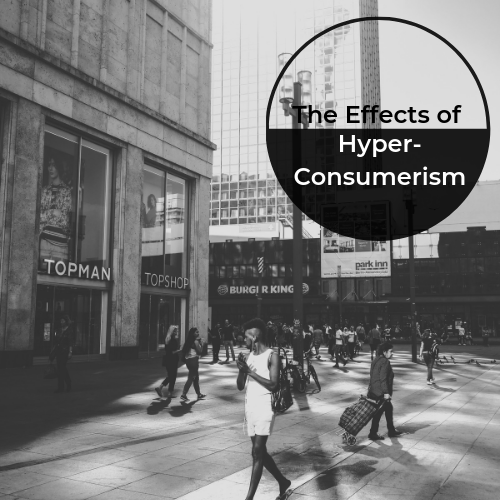 """Photo by  frederik danko  on  Unsplash . [image description: Black and white photo of a Black person walking down a busy city street. Title in top-right corner reads, """"The Effects of Hyper-Consumerism"""".]"""