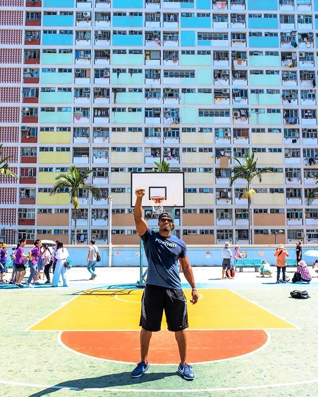 """Behind me are some of the public housing buildings in Hong Kong. They are called """"Choi Hung,"""" which in Cantonese means """"rainbow."""" Basically, I'm at the rainbow projects, and I hope this dope picture brings you a light of POSITIVITY. ⠀⠀⠀ ⠀ Check out my IG story to see what I did on this court! ⠀⠀⠀ ⠀ ⠀⠀⠀ ⠀ 📷: @johnny.sze"""