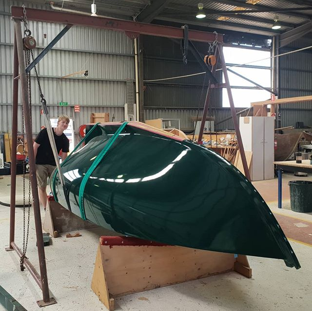 Finally ready to turn the #haven12 . Now finally time to finish that inside. Hull paint has come up a treat! Will do waterline and bootop later on  #woodenboat #boatbuilding #woodenboatcentre #docklands #turningday #stripplanking #wooden #timber #internationalpaint #fitout #wheresthoseplans