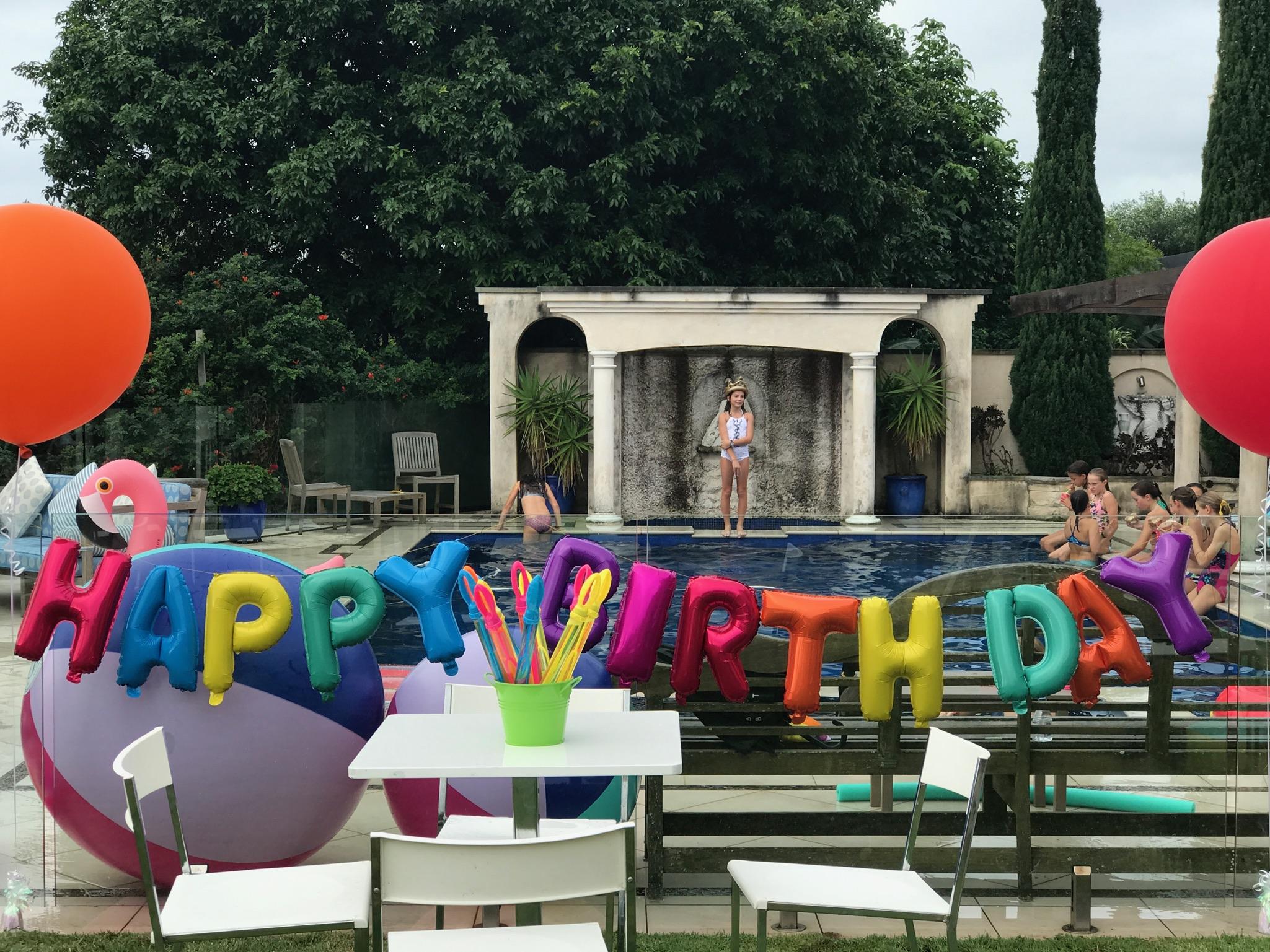 A Rainbow Pool Party  for Neve's Rainbow Unicorn Themed Birthday Party