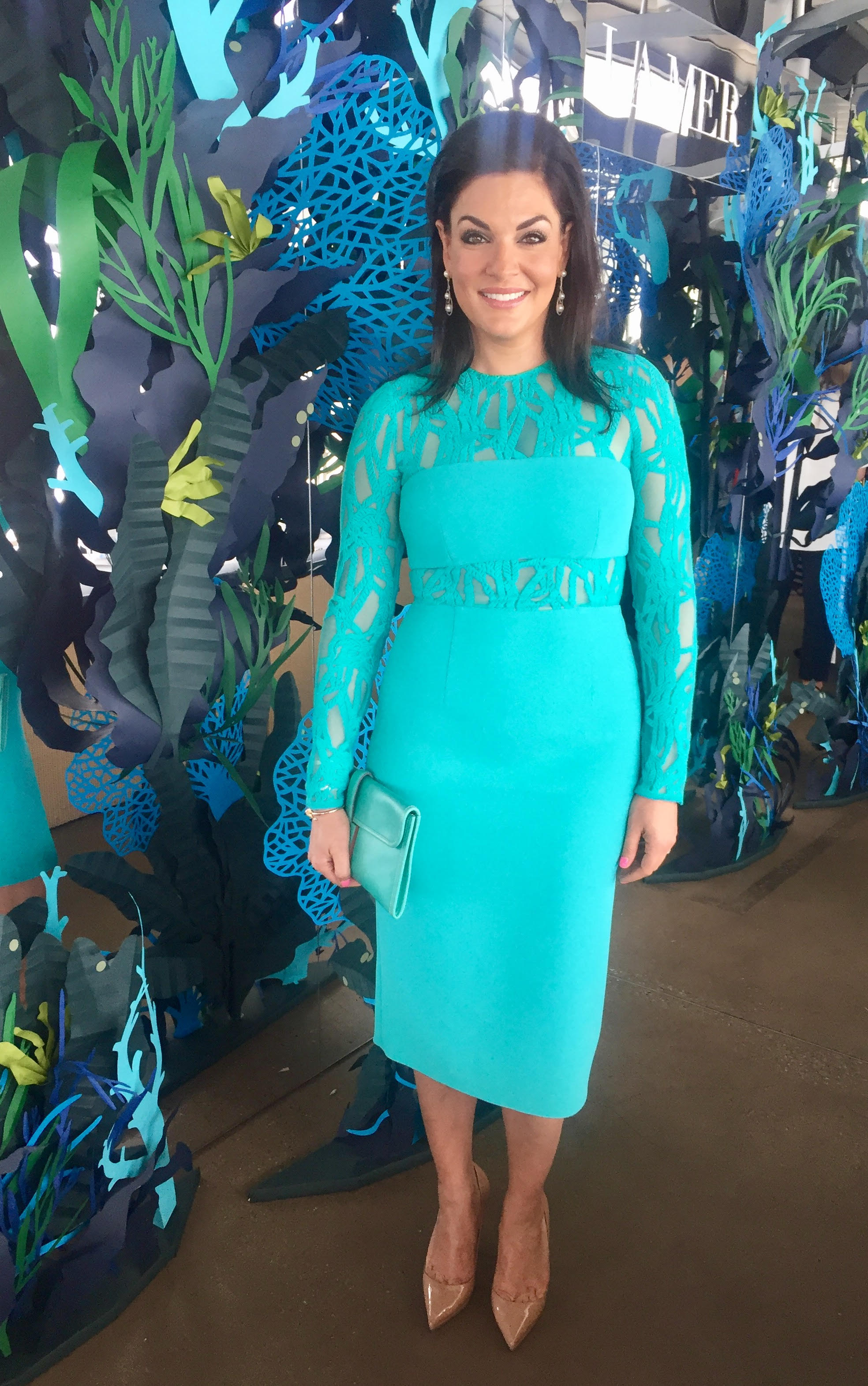 Get the Look: Aqua Cocktail Dress Outfit | Find out what Nicole O'Neil from The Real Housewives of Sydney wore for La Mer's World Oceans Day Blue Heart Event.