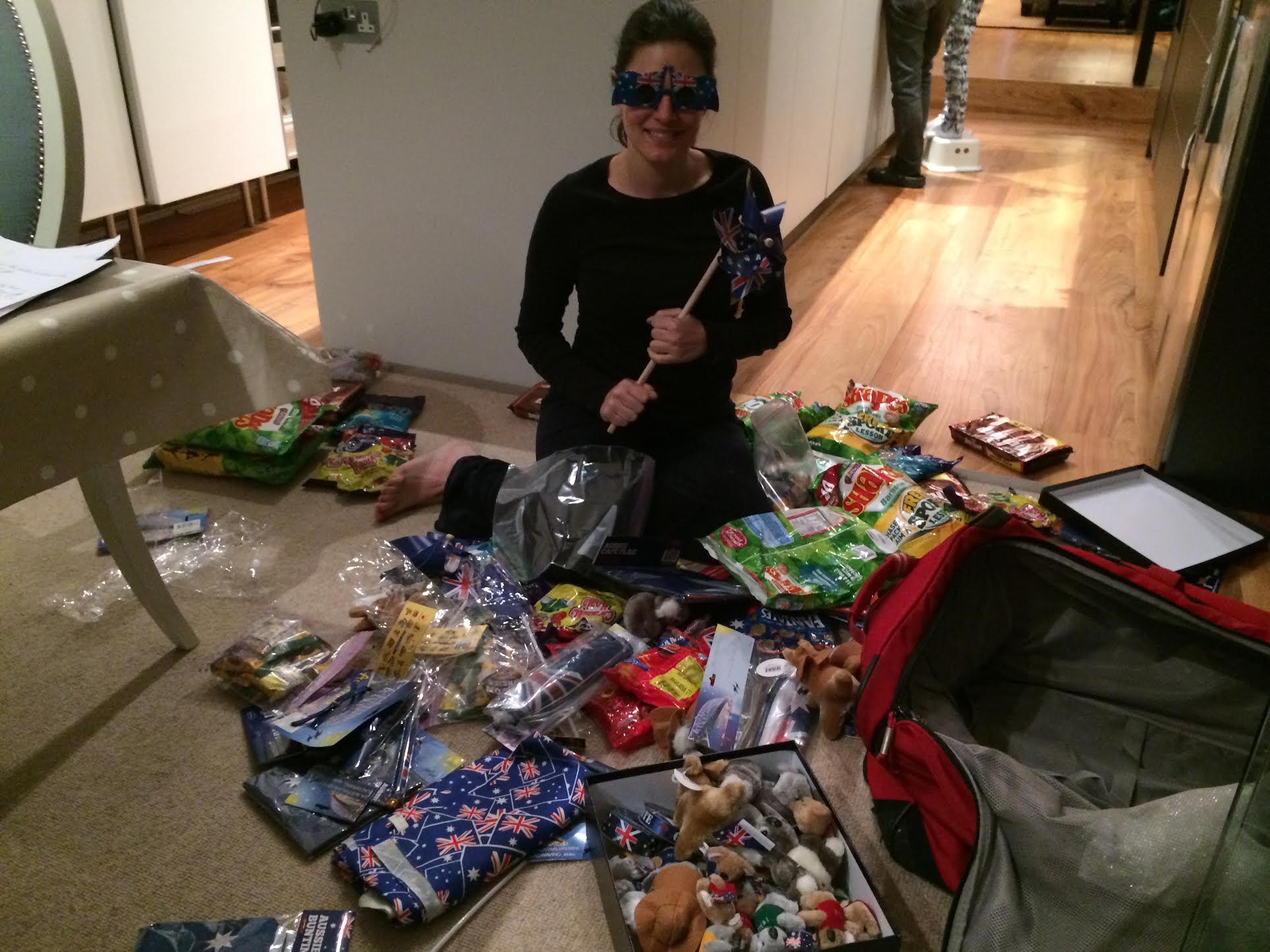 Nicole with a suitcase full of Australian treats.jpg