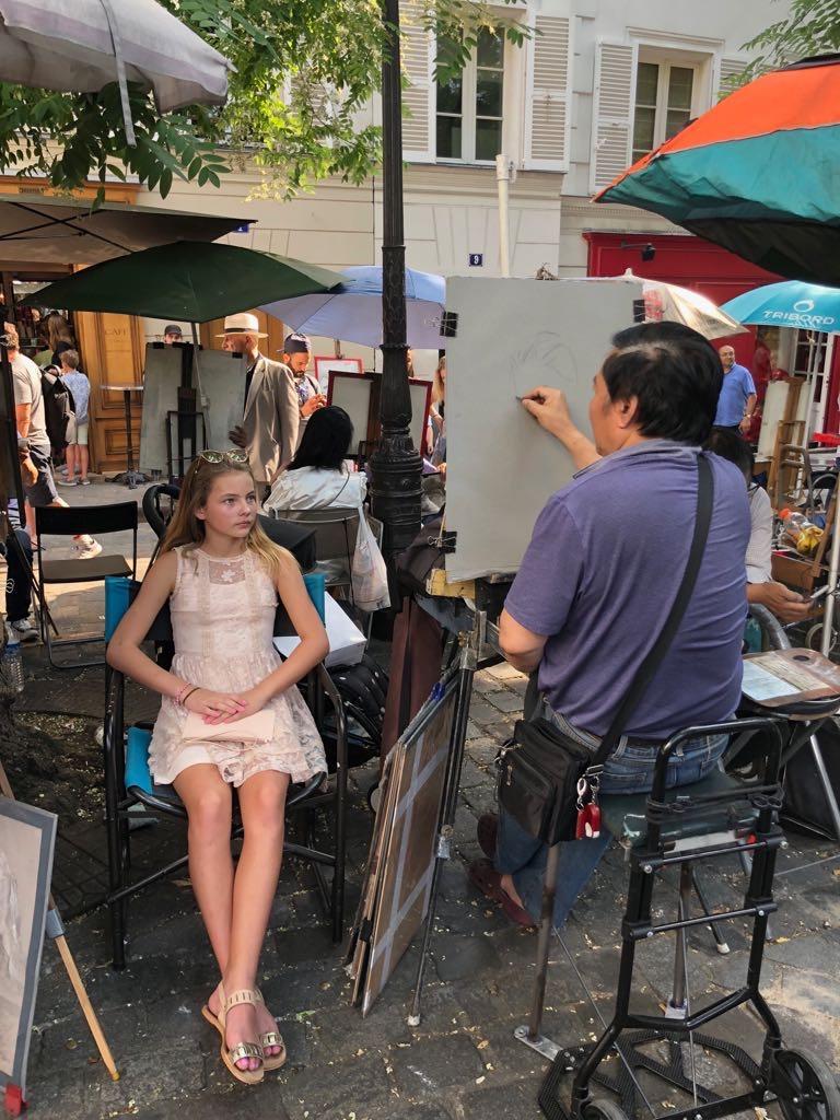 Having a sketch portrait done at Montmarte Paris Place du Tertre.jpg