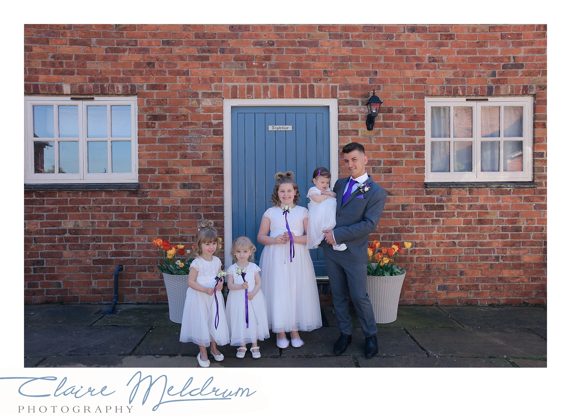 Two grooms and wedding party, Claire Meldrum Photography