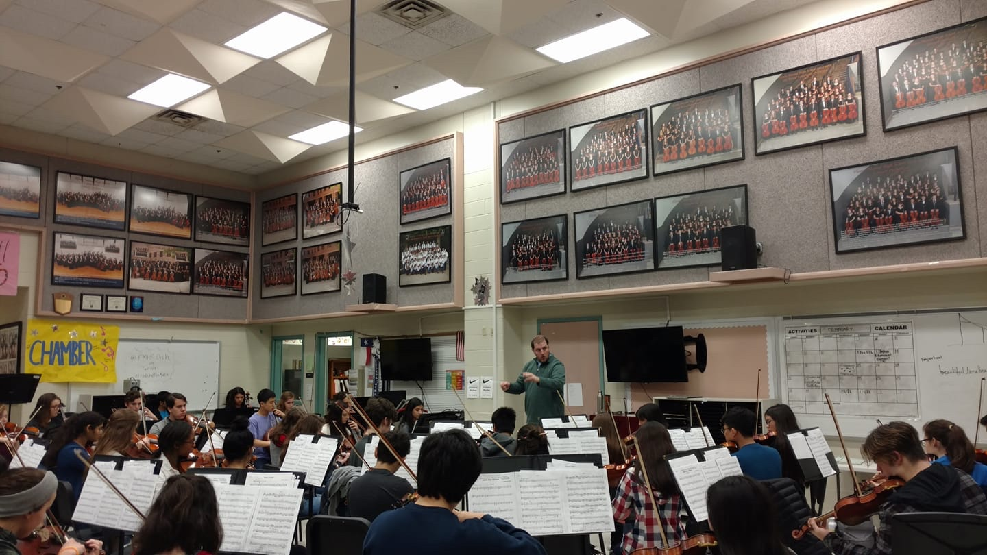 Jordan conducts music students at Flower Mound High School in Dallas, 2018.