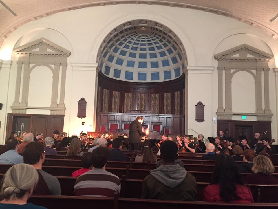 Jordan Randall Smith conducts the Hopkins Concert Orchestra at the Johns Hopkins University Interfaith Center.