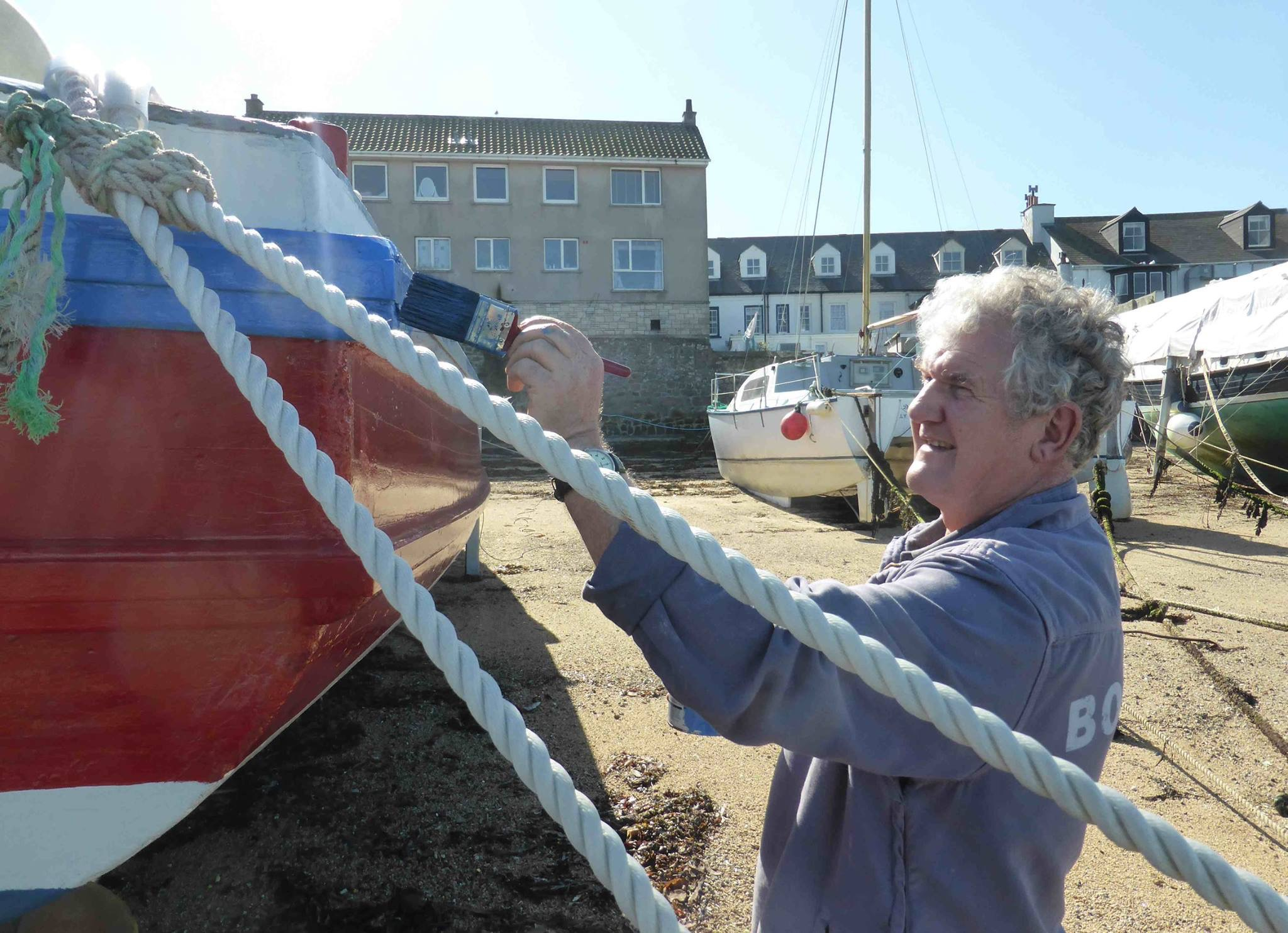 Fraser Hicks putting a final lick of paint on his vessel - Sea King.
