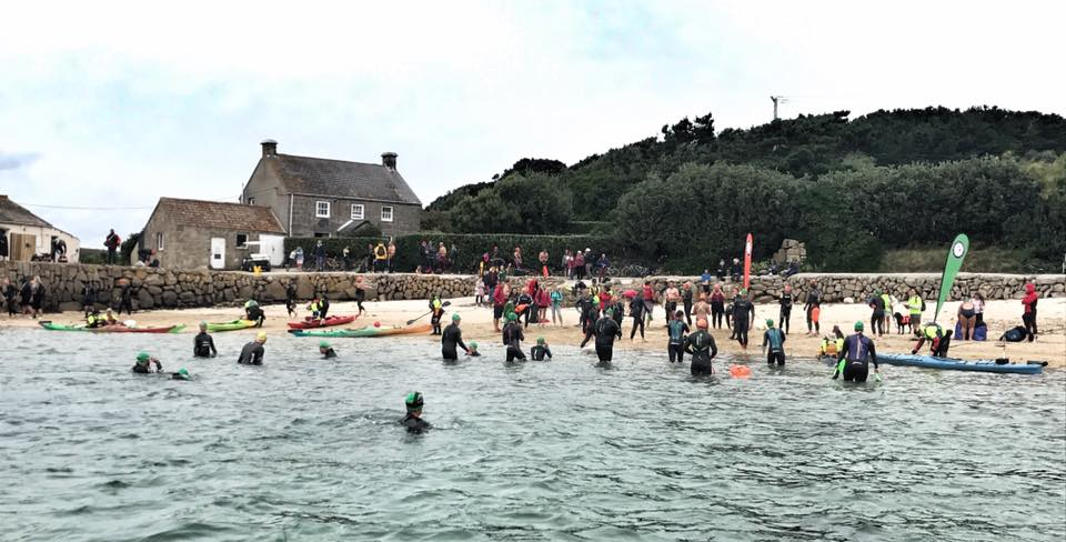 Competitors exciting water in Tresco. Image courtesy of Scilly Swim Challenge.