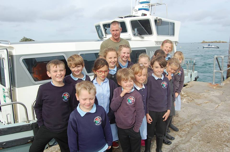 The Tresco and Bryher Children had a brilliant tour of the medical launch recently which included a trip to Round Island last week with Skipper James Terry also pictured. Image courtesy of Five Islands school.