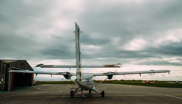Twin Otter aircraft on the ground at Land's End Airport.