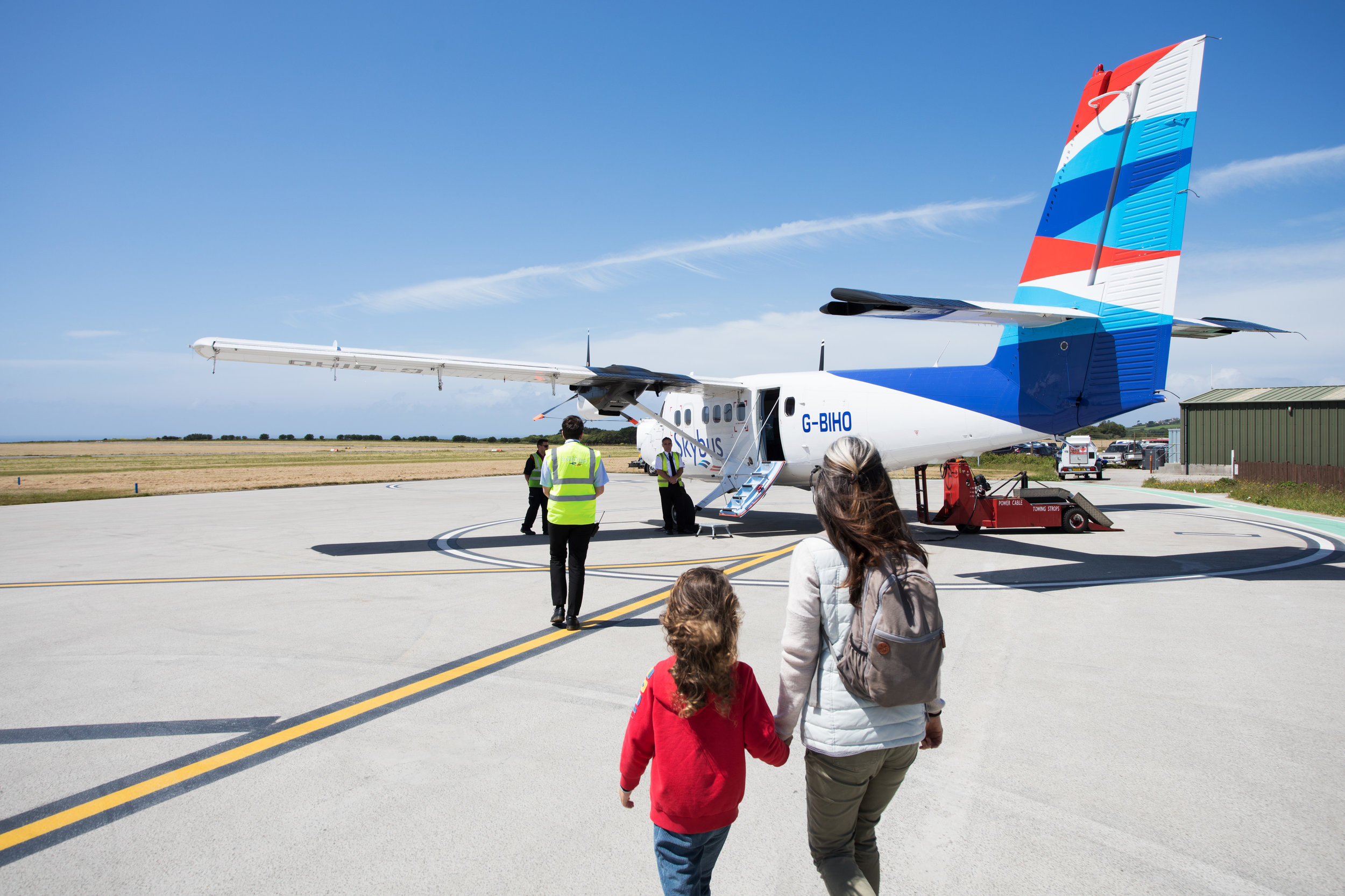 Passengers making their way out to a Skybus Twin Otter aircraft.