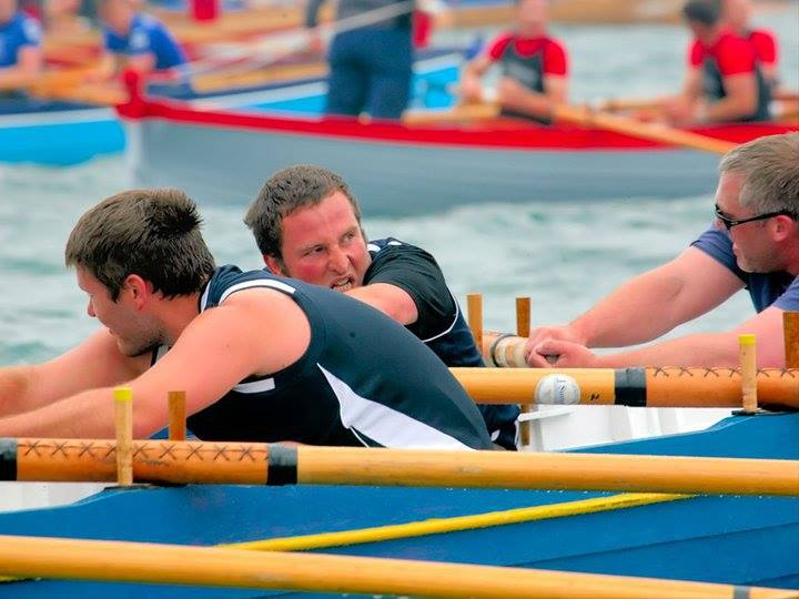 Chris far left rowing with Pendeen Pilot Gig Club's Men's A team.Image courtesy of The Chris Cox Tribute & Memorial Fund.