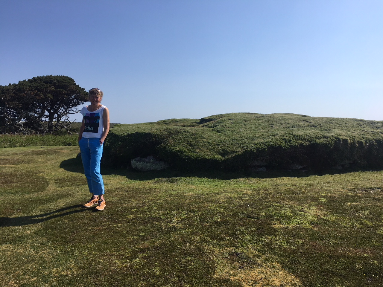 Helen Pearce standing in front of the burial chamber near Porthhelick.