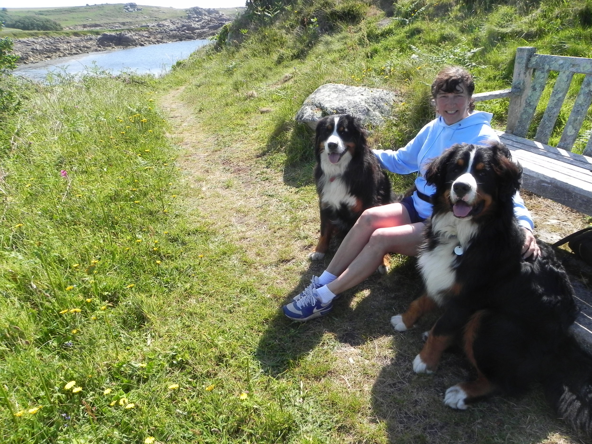 """""""Dear all  Ian and I have been visiting the Isles of Scilly for over 30 years; initially on our own, adding Mum and Dad and our three daughters on the way, plus our beautiful Bernese Mountain Dogs. Kensa sadly is no longer with us but I am pictured with Emrys (4) and Meryn (9 months). Although we live in Cornwall, the Isles of Scilly are so special; you feel you have arrived """"home"""". I heard about my winnings the day before our holiday towards the end of May this year and have already re-booked for next year. Many thanks. Diane """""""