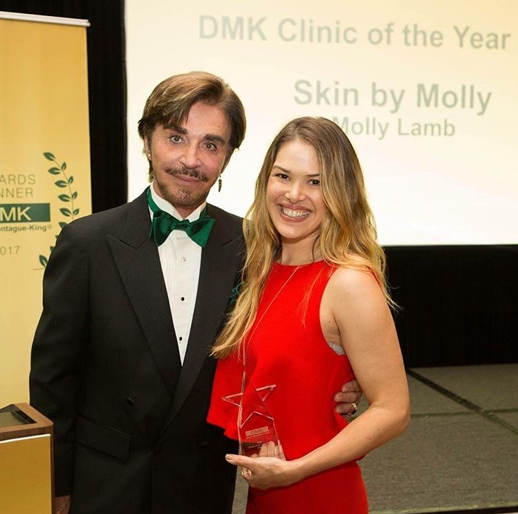 Molly accepting Skin By Molly's award for DMK Clinic of the Year, 2017