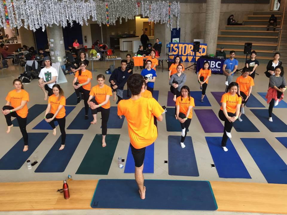 Timurlane leading a yoga class at UBC's Annual Storm the Wall event.