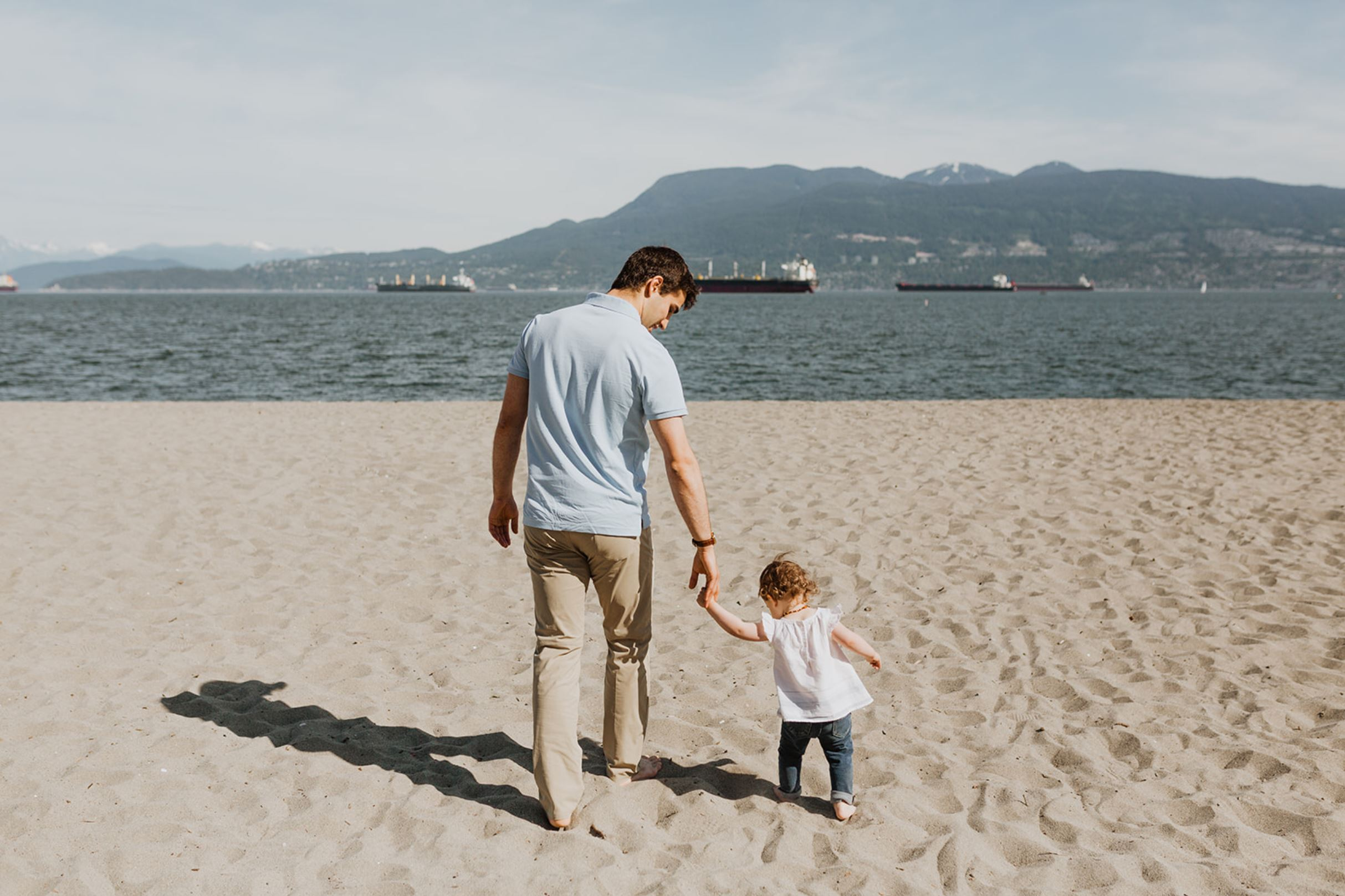 Timurlane and Zara holding hands walking at Jerico Beach in Vancouver, May 2019. (Photo Credits to  Brenna Louise ).