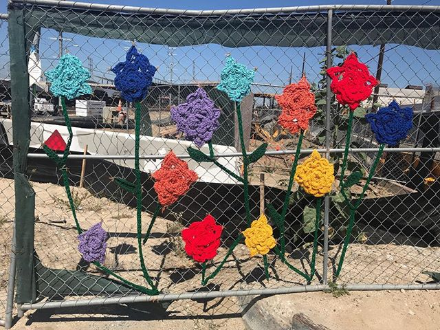 Chainlink beautification. Crochet bombing #dtla #yarnbombing #crochetbomb