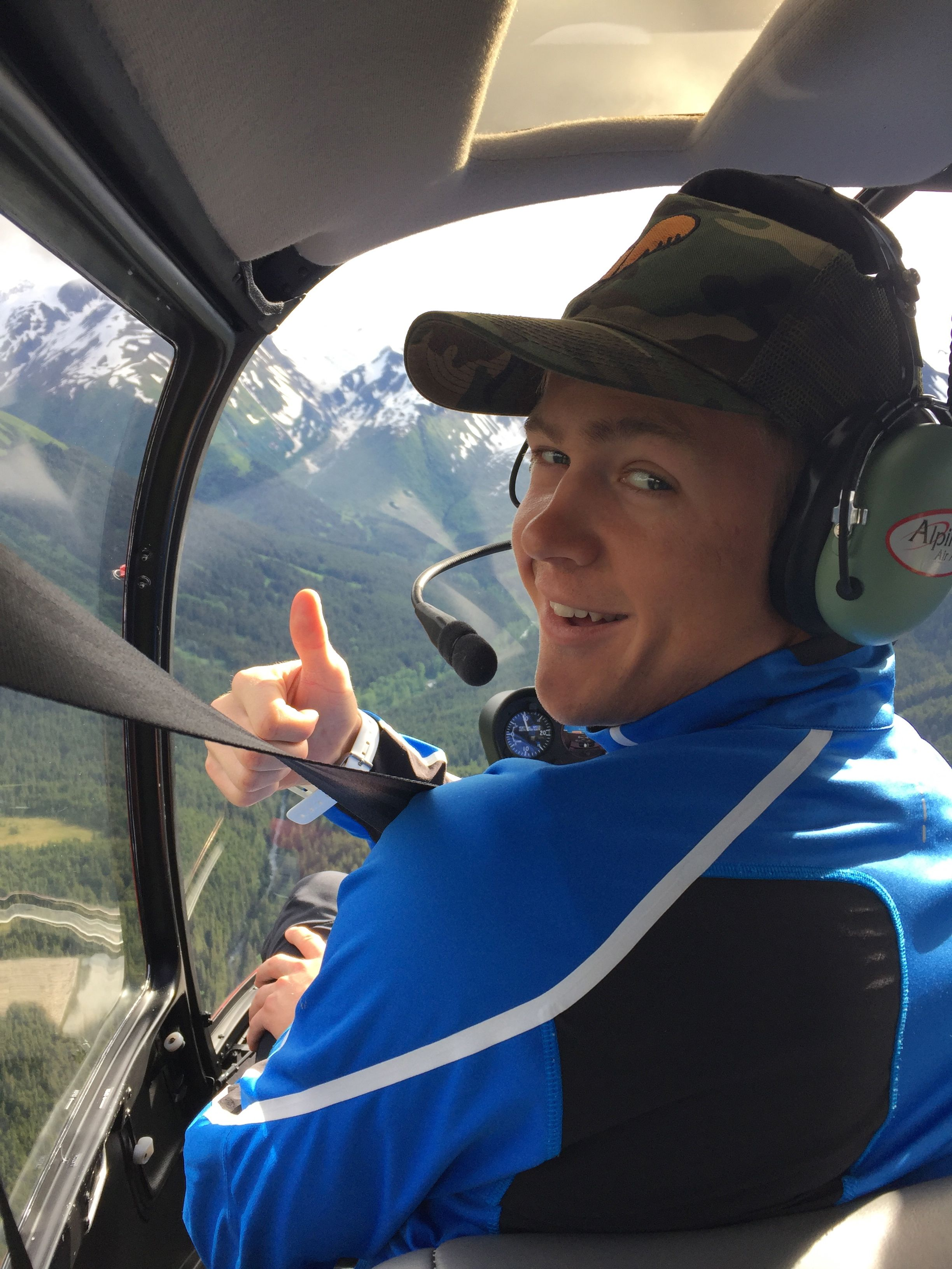 """Erik, pretty excited as we head up in our """"mountain taxi"""". Thanks to Alpine Air, we always get delivered and picked up safely to our little """"heaven"""" up in the mountains!"""