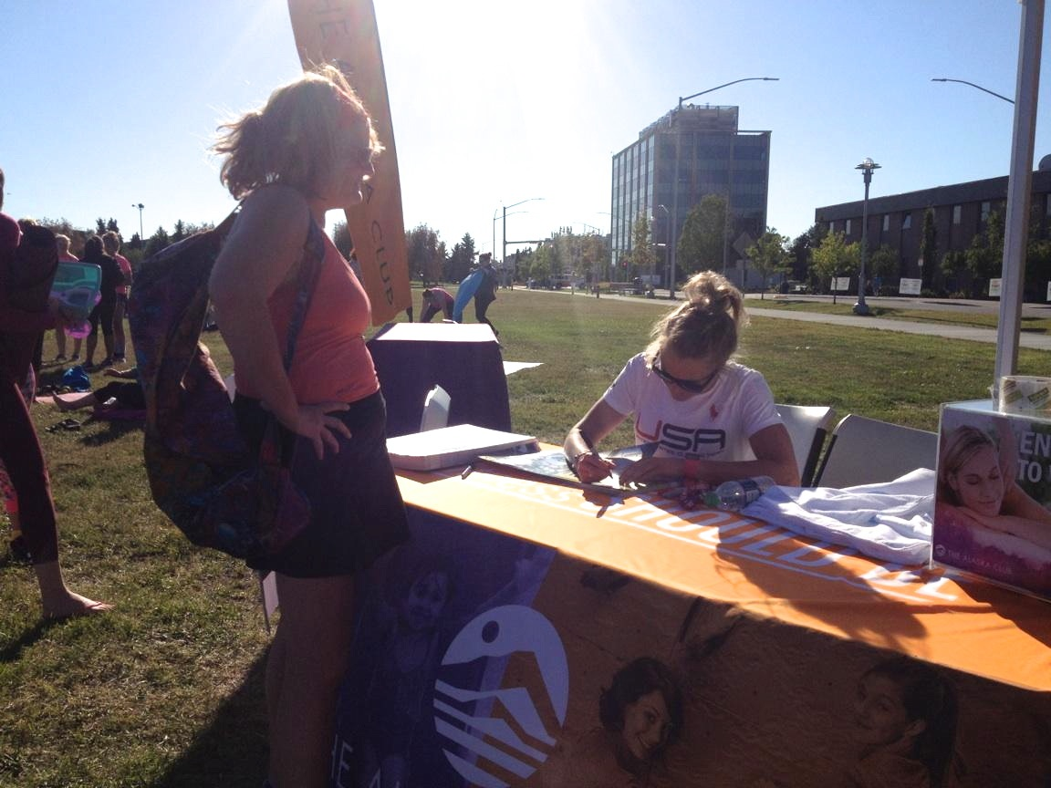 Poster signing at Yoga in the Park.