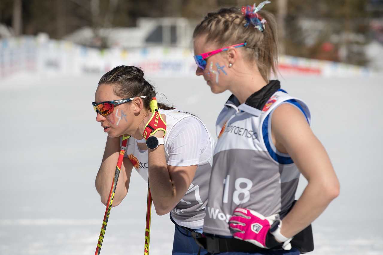 Talking race tactics with Julia Kern before the start of the relay. So fun and exciting to know she is eight years younger than me and was starting her first ever 4x5km relay with the team. It was incredible to watch her fearlessly attack that first leg of the relay. There is no doubt this girl is full of guts! (Reese Brown photo)