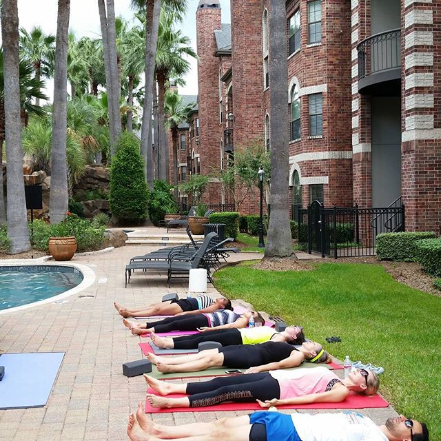 Michael led a yoga session for a group of residents of a Galleria-area apartment complex. While it was a hot and sweaty time,everyone enjoyed it.