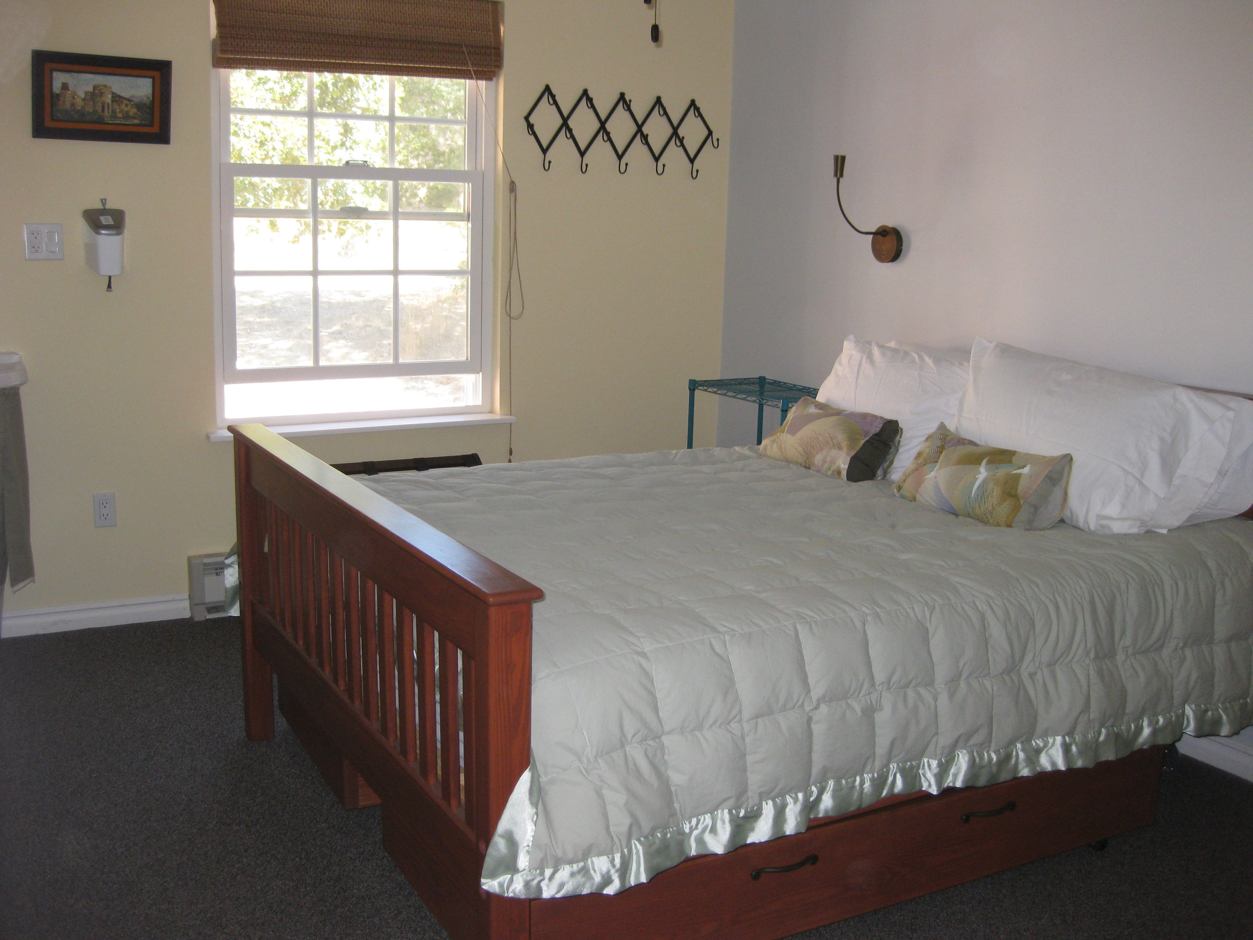 Bright Lodge House bedrooms—quality bedding, reading lights, and storage