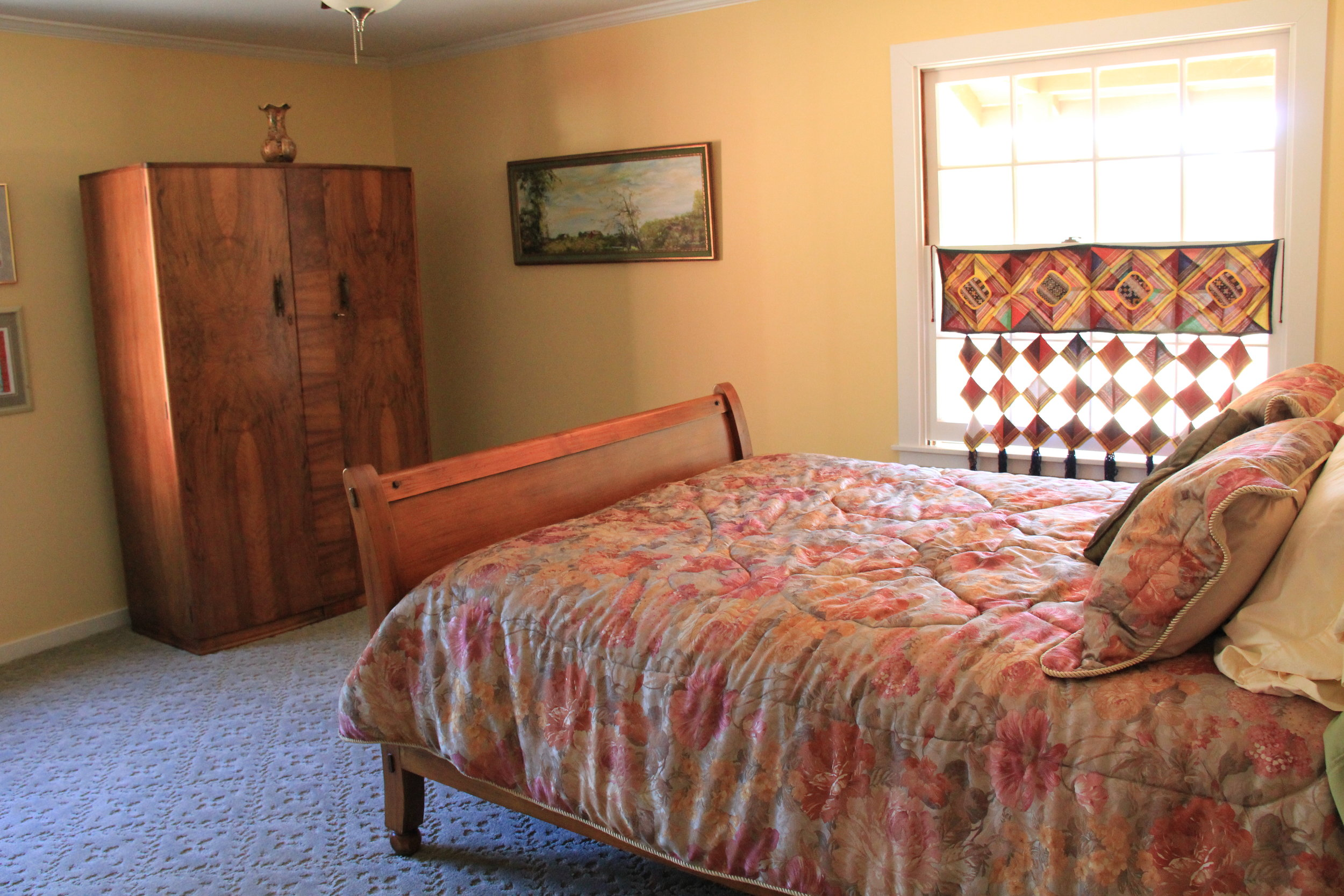 Cozy, comfy bedding awaits you in the Ranch House's second bedroom