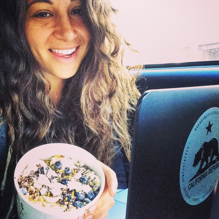 Me! Casually eating an acai bowl and working in the car on my way to Lake Tahoe.