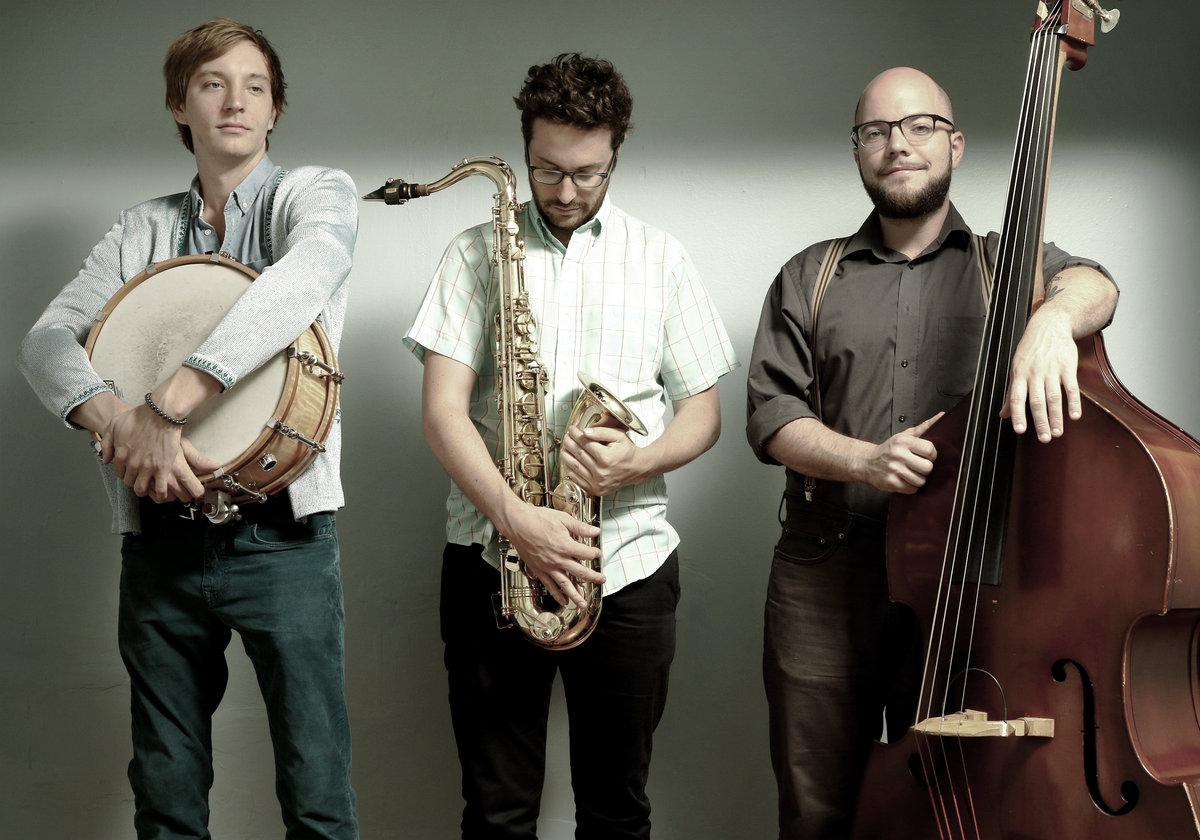 Shawn Myers, drums.    Byron Asher, tenor saxophone/clarinet.  Trey Boudreaux, bass.