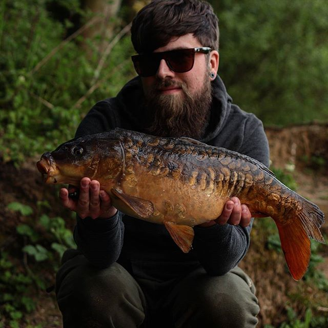 This bearded man is not George Cartwright..but that is a smashing carp!