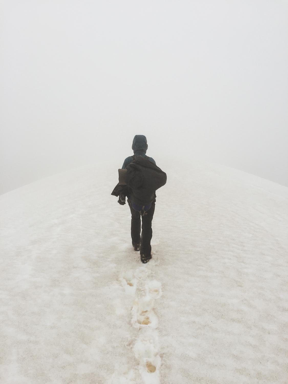 Walking on a ridge towards the mountain