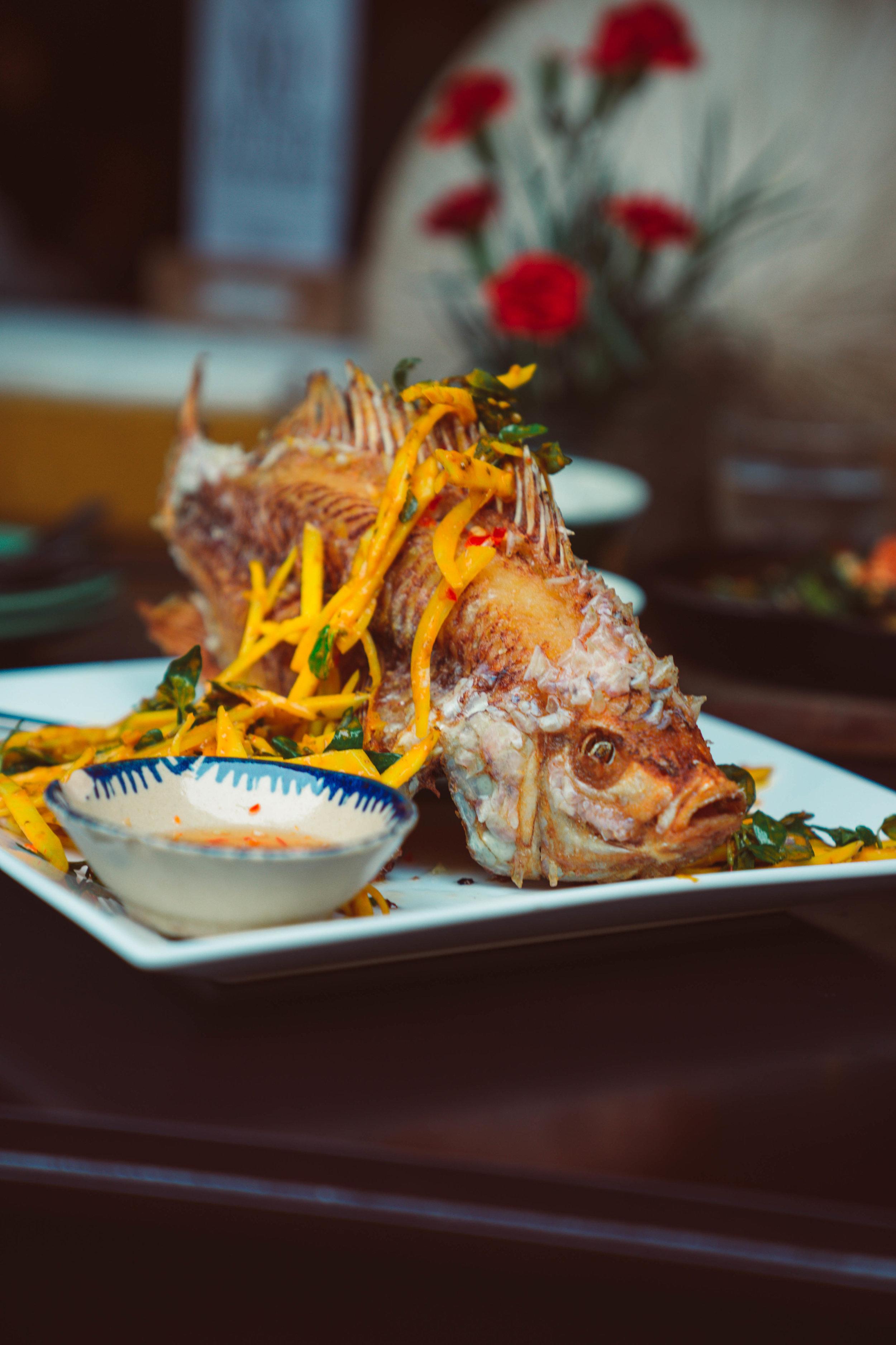 Deep fried elephant ear fish with mango and papaya salad from Morning Glory, Hoi An