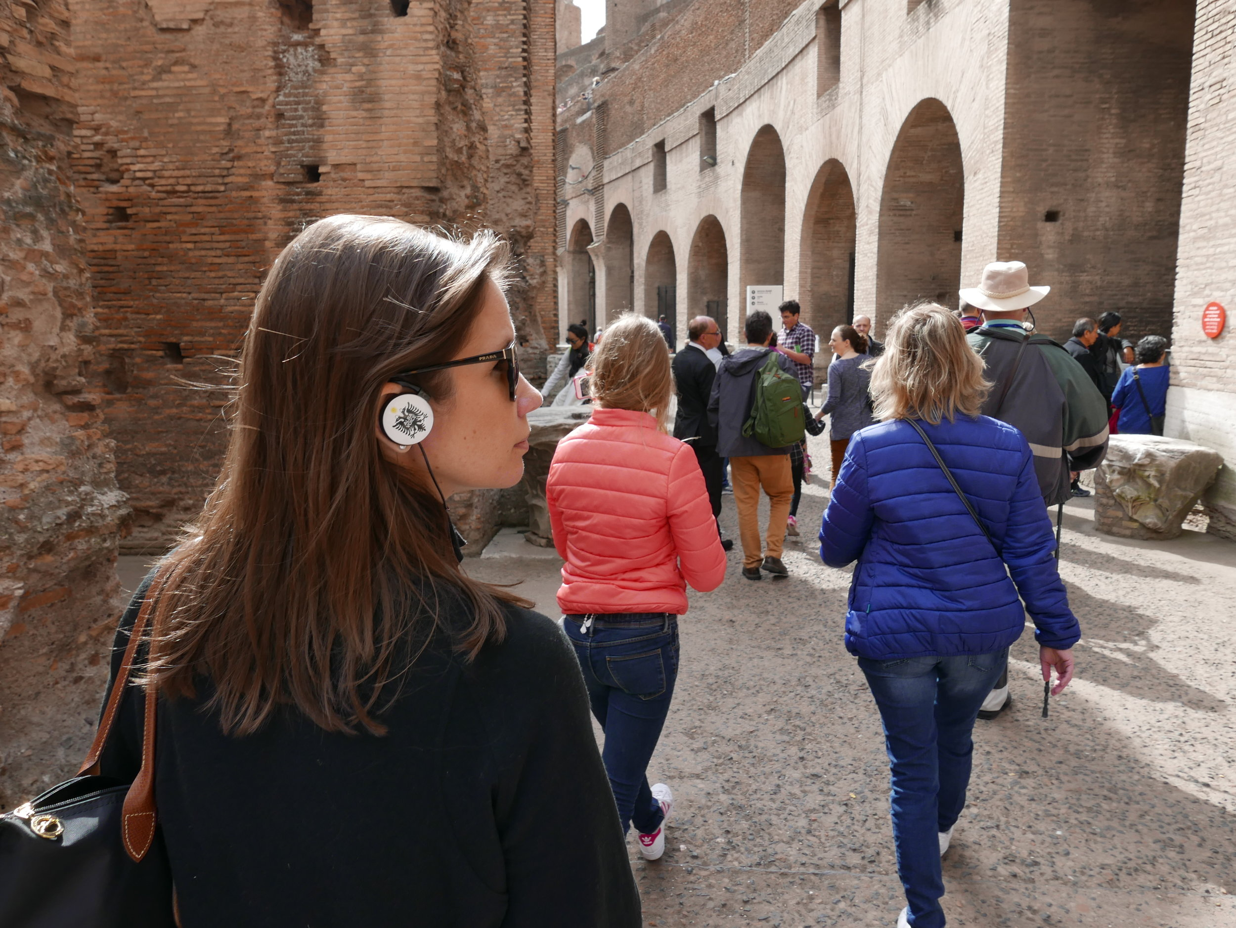 Two tips when going on a tour of the Colosseum: 1) bring your own earbuds if you don't want to wear the  uber  fashionable one-eared earbud (as pictured above)! 2) At least in the springtime, all that stone in the Colosseum traps in the cold air. In this instance, I was wearing not only my fleece, but Paul's too because I was freezing! So make sure you layer, even if it is a nice day out.