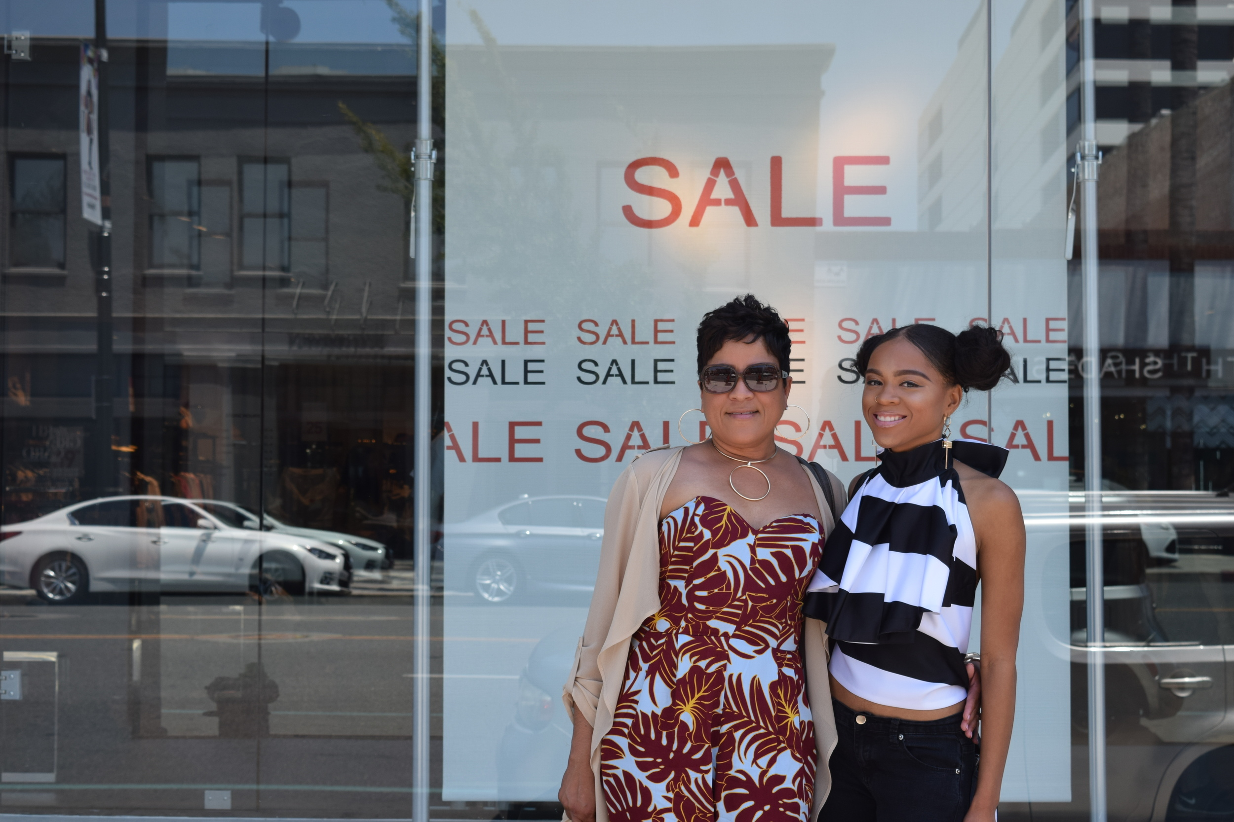 Me and my baby girl in old town Pasadena stopping to take a few pics in front of Zara's!