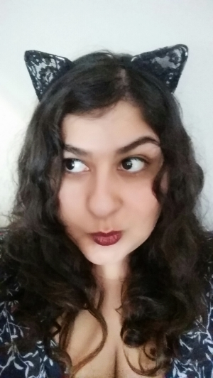Jenn tries on cat ears. Gives them 4 stars. 5 stars for a fierce red lip though.