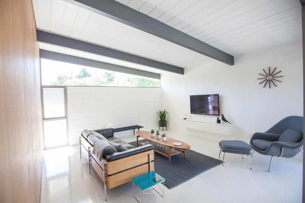 The couple's approach to their renovation has been nearly 100% DIY, similar to us, which is why naturally we get along so well ;). They installed all new VCT floors and restored their home's original paneling to its natural beauty.